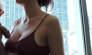 Amazing blowjob in a hotel room window